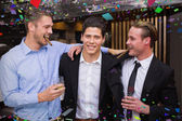 Handsome friends having a drink together — Photo