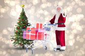 Santa pushing a shopping cart — Stock Photo
