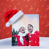 Composite image of festive young couple — Foto Stock
