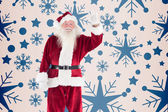Jolly Santa waving at camera — Stock Photo