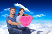 Couple holding a large heart — Stock Photo
