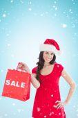 Festive brunette holding sale bag — Stock Photo