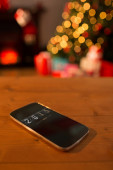 2015 against smartphone on table — Stockfoto
