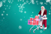 Santa pushes shopping cart — Stockfoto