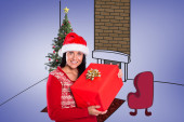 Brunette with christmas present — Stok fotoğraf