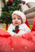 Baby boy in large christmas present — Stock fotografie