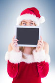 Pretty santa girl holding tablet — Stock Photo