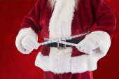 Santa Claus measures his belly — Stock Photo