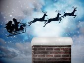 Santa flying against twinkling stars — Stockfoto