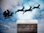 Santa flying against twinkling stars — Foto Stock