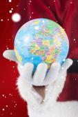Santa has globe in hand — Stock Photo