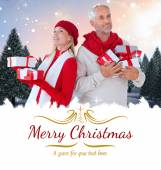 Happy festive couple with gifts — Stock Photo