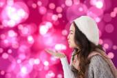 Brunette in winter clothes blowing kiss — Foto Stock