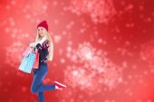 Blonde holding shopping bags — Stock Photo