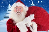 Jolly Santa carries his sack — Stock Photo