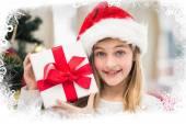 Festive little girl holding gift — Stock Photo