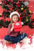 Festive little girl opening a gift — Stock Photo