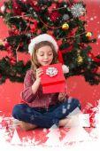 Festive little girl opening a gift — Stockfoto