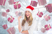 Blonde holding fan of dollars — Stock Photo