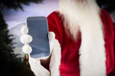 Santa claus showing smartphone — 图库照片