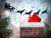 Santa flying behind chimney — Stockfoto