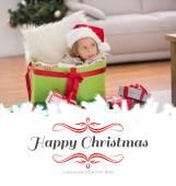 Little girl sitting in giant christmas gift — Stock Photo