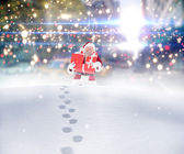 Santa carrying gifts in the snow — Stock Photo