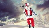 Santa claus holding ski and ski poles — Stock Photo
