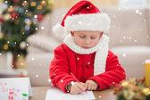 Festive little boy writing wish list — Stock Photo