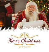 圣诞老人写他与羽毛笔的列表 — 图库照片