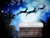 Santa flying his sleigh — Stock Photo