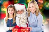 Mother and daughter with santa claus — Stock Photo