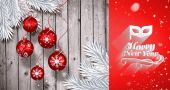 Christmas baubles hanging over wood — Foto de Stock