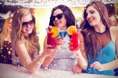 Composite image of friends drinking cocktails — Stock Photo