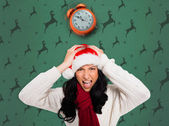 Irritated woman in santa hat — Stock Photo