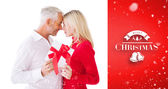 Couple passing wrapped gift — Stock Photo
