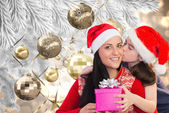 Composite image of mother and daughter with gift — Foto de Stock