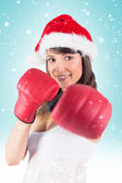 Brunette punching with boxing gloves — Stock Photo
