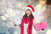 Yelling brunette holding clock and gift — Stock Photo