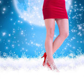 Girl in red skirt and heels — Stock Photo
