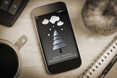 Fir tree against overhead of smartphone — Stock Photo