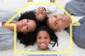 Smiling young family lying on floor — Stock Photo
