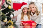 Mother and daughter beside christmas tree — Stock Photo