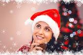 Festive brunette wearing a santa hat — Stock Photo