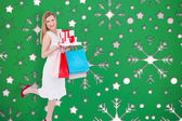 Blonde with presents against snowflake — Stock Photo