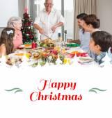 Family at dining table for christmas dinner — Foto de Stock