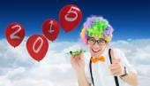 Geek ready to party against balloons — Stock Photo