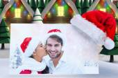Festive young couple holding gift — Foto Stock