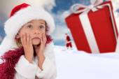 Cute little girl wearing santa hat and tinsel — ストック写真