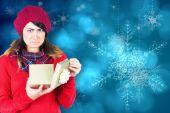 Unhappy brunette opening christmas gift — Stockfoto